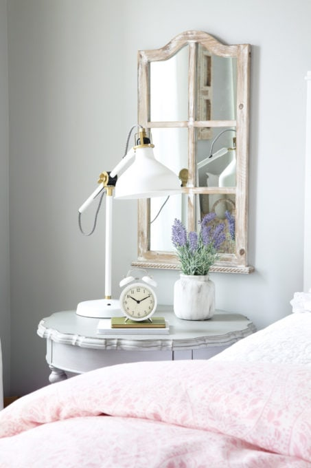 Round Gray Nightstand in a Cottage Style Bedroom
