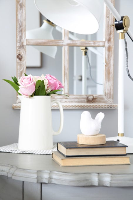 Pink and White Roses on a Round Gray Nightstand