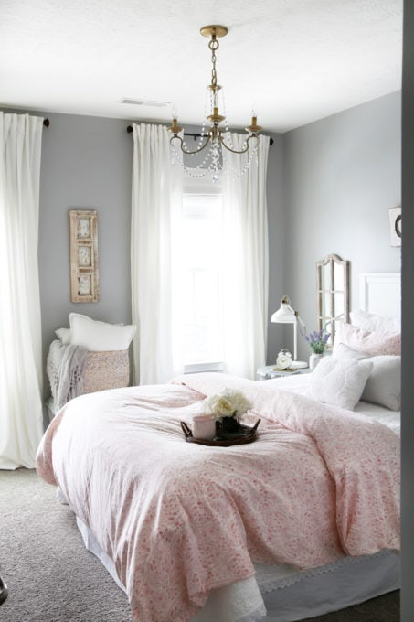 Pink, Gray, and White Guest Bedroom with Brass and Wood Accents