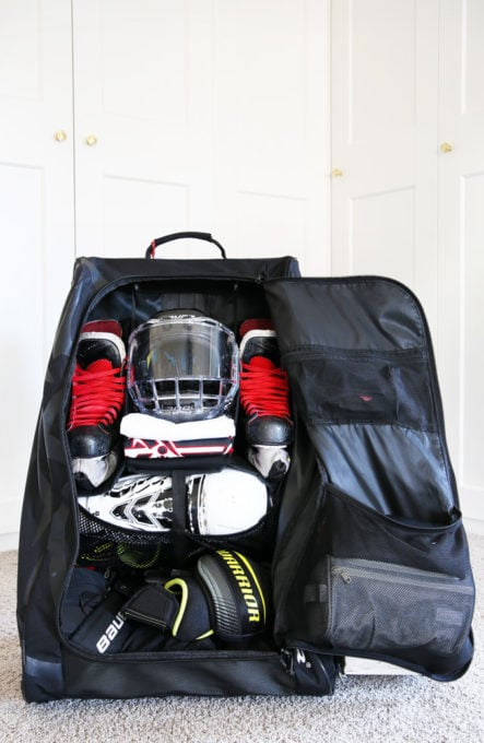 Organized Hockey Bag with Skates, Helmet, Jerseys, and Pads