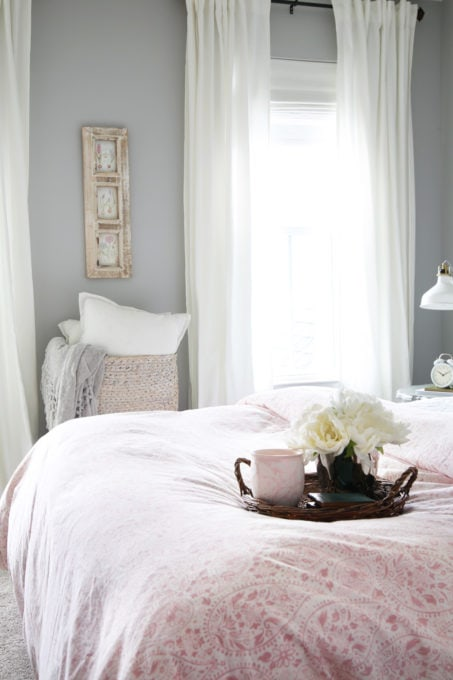 Pink, Gray and White Guest Bedroom with White Curtains and Roman Shades