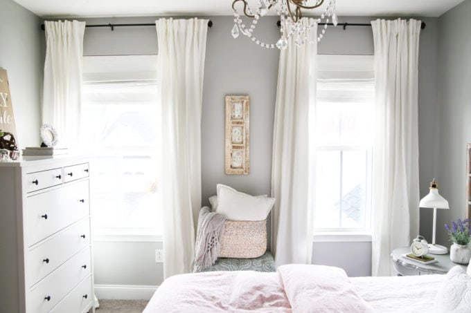 Guest Bedroom with White Curtains and Pink Accents