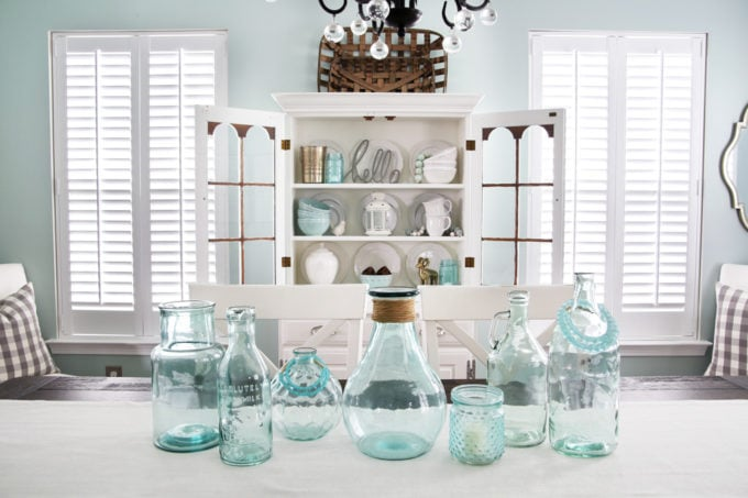 Dining Room with a White China Cabinet and Blue Glass Jars
