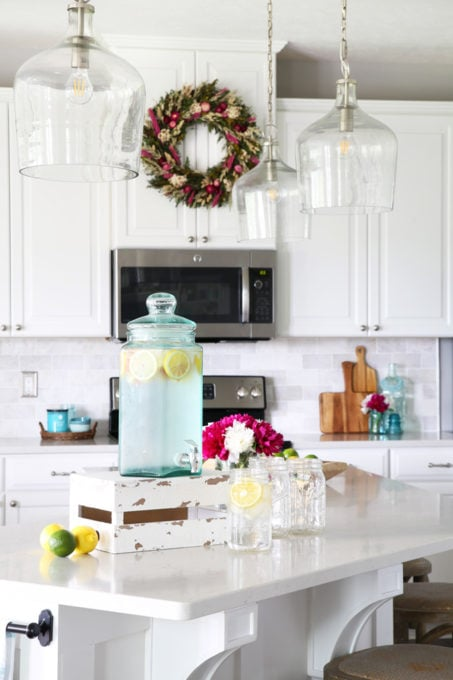 White Kitchen with Marble Backsplash and Pops of Aqua