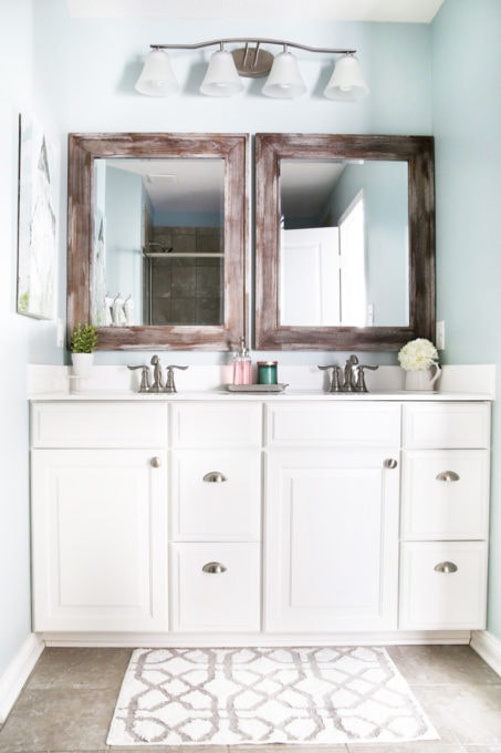 Master Bathroom with White Vanity and Wood Framed Mirrors