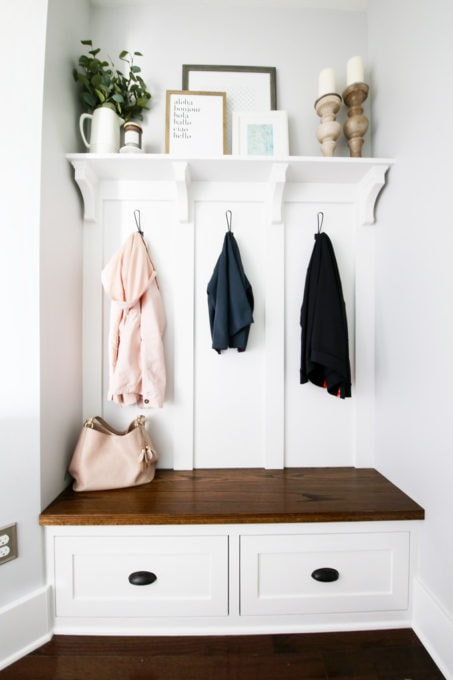 Jackets Hanging in a Mudroom with Built-in Bench and Shelf