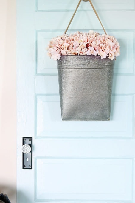 Aqua paint colors can be tough to sort through to find the perfect blend of blue and green for your space, so I'm sharing my 10 favorite aqua paint colors that will make any room feel soothing and serene! | #aqua #aquapaintcolors #aquapaint #mintpaint #mintpaintcolors #paintcolors #bestpaintcolors , Painted Door in Behr Clear Pond at Half Strength