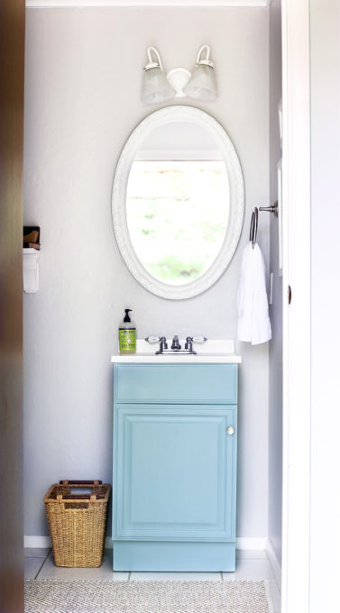 Aqua paint colors can be tough to sort through to find the perfect blend of blue and green for your space, so I'm sharing my 10 favorite aqua paint colors that will make any room feel soothing and serene! | #aqua #aquapaintcolors #aquapaint #mintpaint #mintpaintcolors #paintcolors #bestpaintcolors , Half Bathroom Vanity in Behr Clear Pond