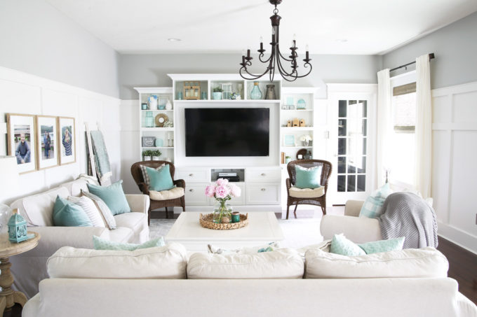 Neutral Living Room with Aqua Accents and High Board and Batten in a Ryan Homes Palermo