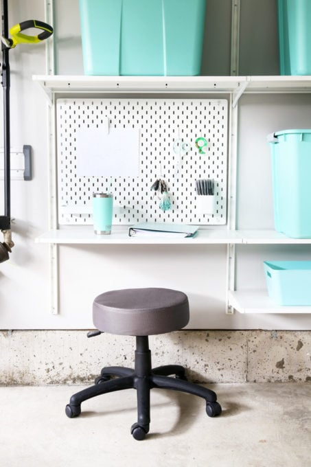 Workstation in an Organized Garage Using IKEA SKADIS Pegboard and IKEA ALGOT Shelving