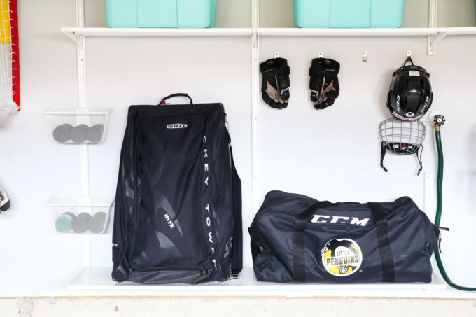 Organized Hockey Equipment Drop Zone in Garage