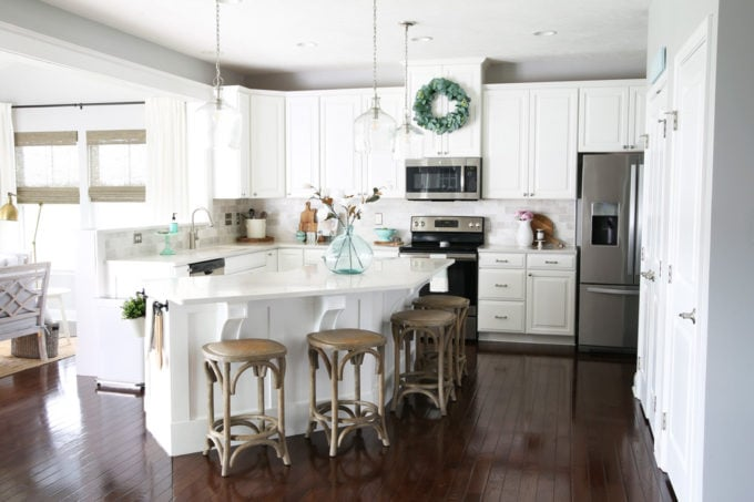 White Kitchen in a Ryan Homes Palermo with Pendant Lights Over the Island