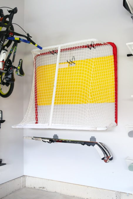 Garage Storage Ideas for a Hockey Net and Hockey Sticks