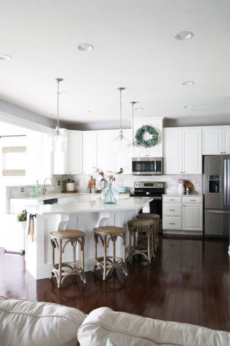 White Kitchen in a Ryan Homes Palermo with Dark Wood Floors