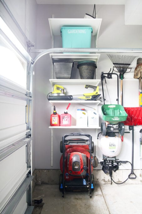 Folding Lawn Mower Storage in an Organized Garage