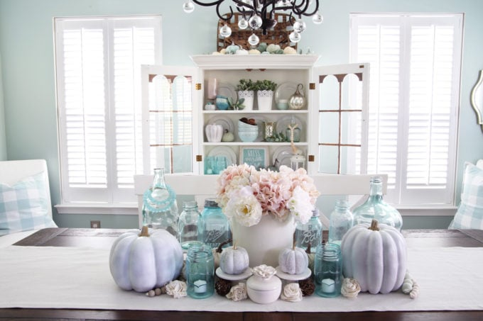Symmetrical Dining Room Centerpiece with Aqua Jars and White Pumpkins
