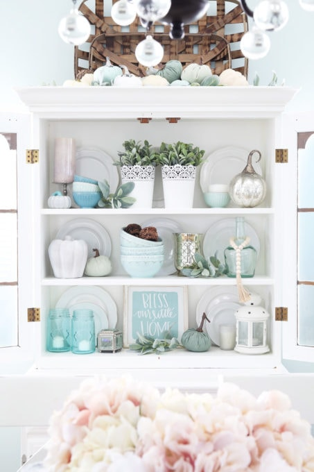 Dining Room Hutch Decorated with Aqua and White Fall Decor