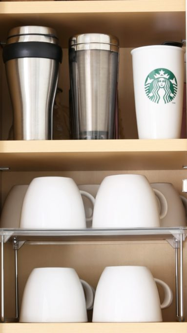 Shelf Organizer to Organize Coffee Mugs in a Kitchen Cabinet