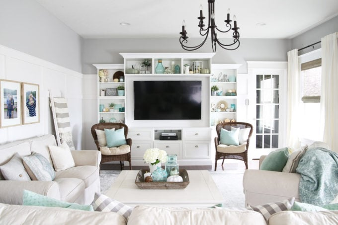 Aqua and white living room with IKEA BESTA built-ins entertainment unit