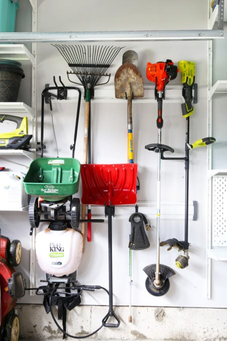 Lawn and Garden Tools Organized with the Gladiator Track System in an Organized Garage