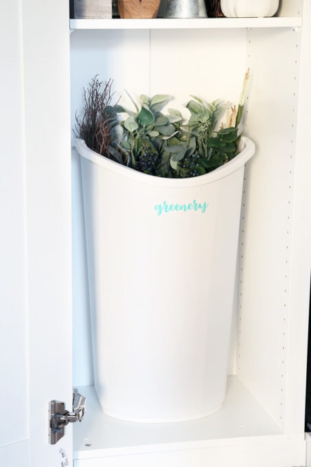 Faux Greenery Organized in a Trash Can in a Home Office