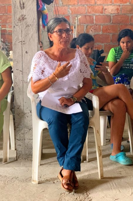 Woman explaining about a sewing program in Ecuador