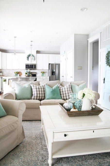 Aqua and white fall living room and kitchen