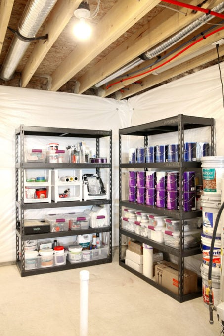 Paint Supplies Organized on Metal Shelving in an Organized Basement