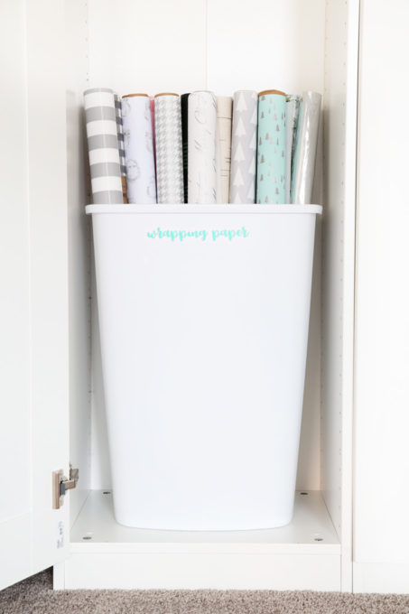 Trash Can Used to Organize Wrapping Paper in a Home Office Closet