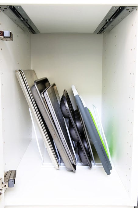 Organized Cookie Sheets and Cutting Boards in a White IKEA Kitchen