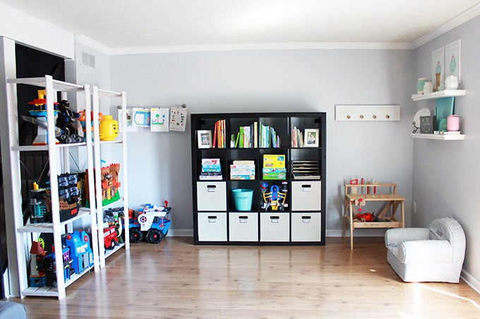 Organized Toy Area in Townhouse with Creative Storage Solutions