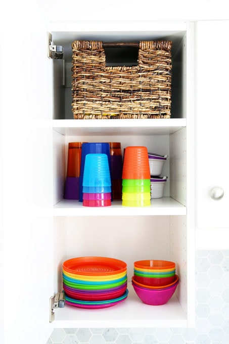 Organized Kids' Plates and Cups in a White IKEA Kitchen