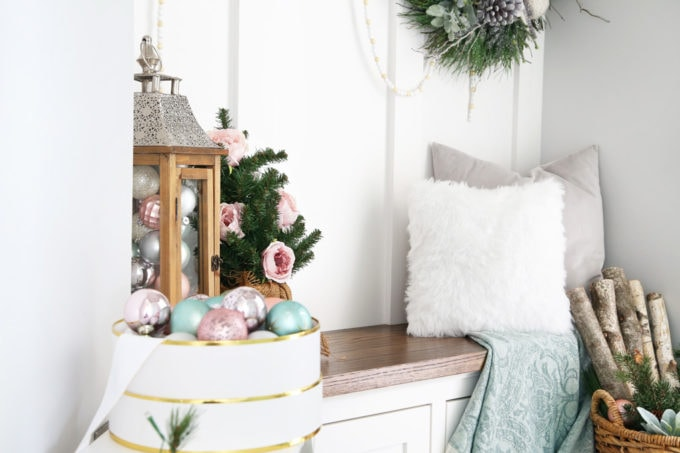Pastel Christmas Ornaments on a Stool in a Mudroom