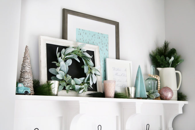 Shelf of Mudroom Built-ins Decorated with Pastel Christmas Decor