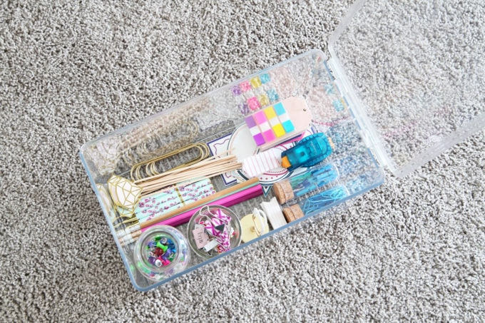 Organized Craft Supplies Bin in a Home Office
