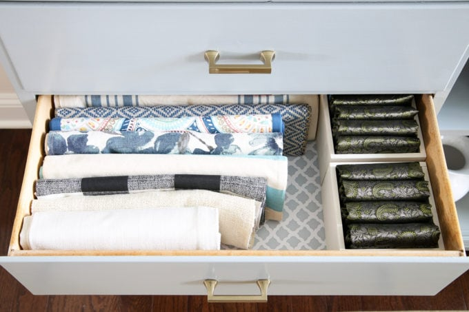 Organized Dining Room Sideboard with Folded Table Runners and Placemats