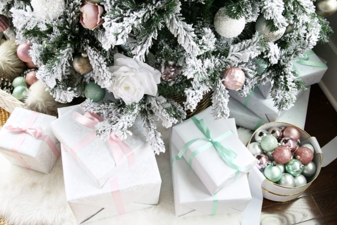 Gifts Wrapped with Pastel Bows Under the Christmas Tree