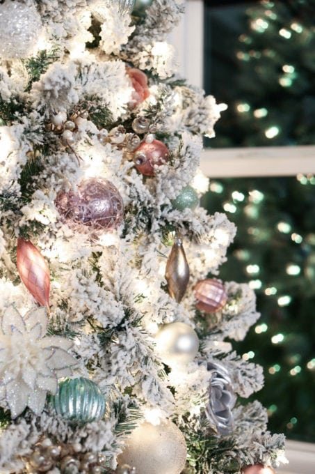 Pastel Christmas Ornaments on a Flocked Tree