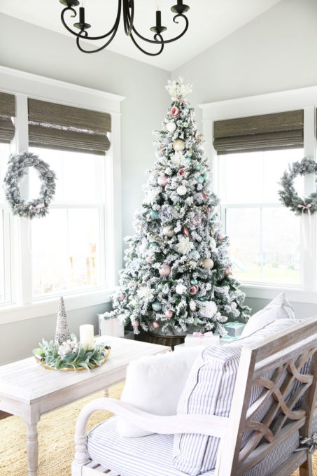 Flocked Christmas Tree in Sunroom with Pastel Ornaments