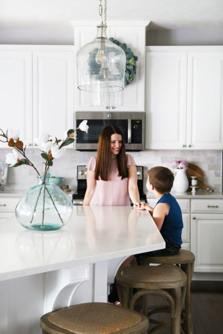 Mother and Son in Organized White Kitchen