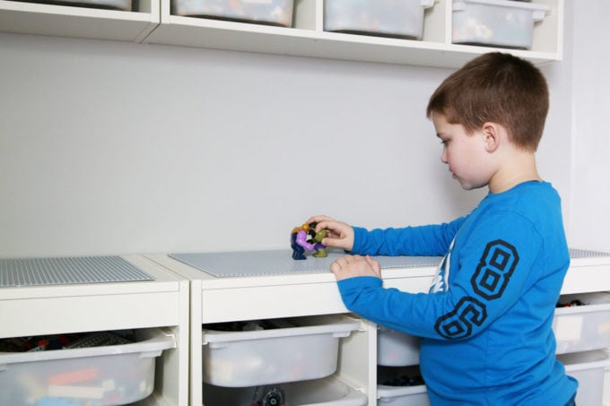 Little Boy Playing on a DIY IKEA LEGO Table with Storage