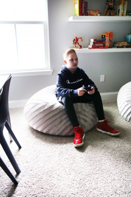 Boy Playing Video Game, Sitting on a Beanbag Chair