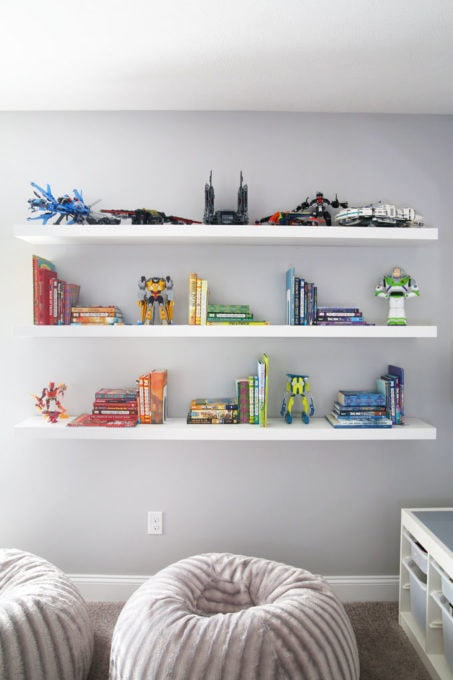 IKEA LACK Floating Shelves Holding Books and LEGO Sets with Beanbags on the Floor