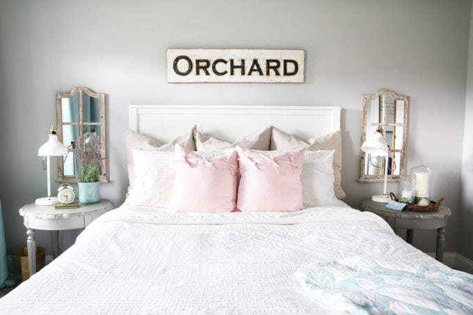 Bed with Pink and Taupe Pillow Covers