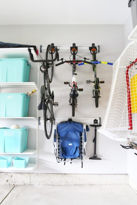 Bikes Hanging on Track System in Organized Garage
