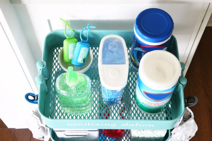 Hand sanitizer, gloves, and Disinfecting wipes on an IKEA RASKOG cart
