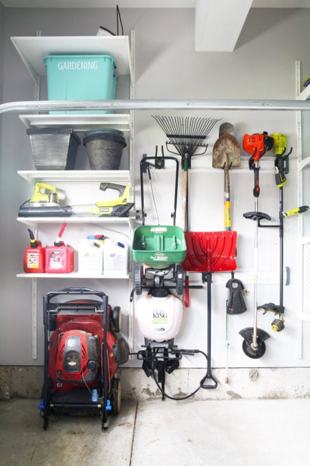 Organized Lawn Care Items in Garage