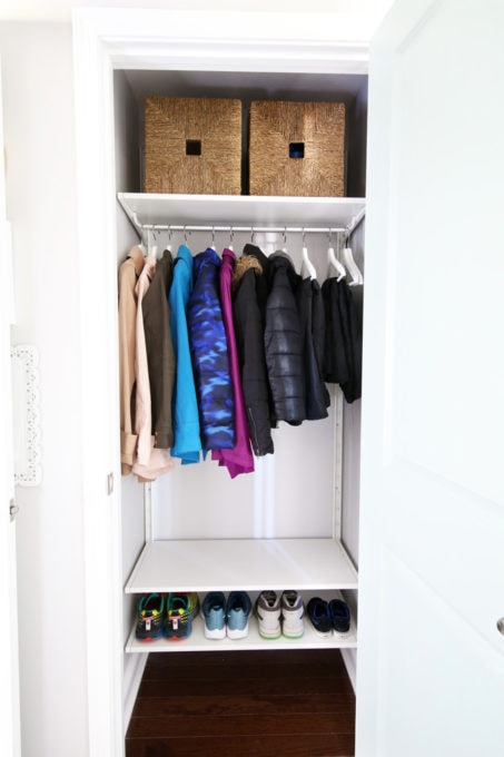 Organized Coat Closet in a Mudroom Entryway