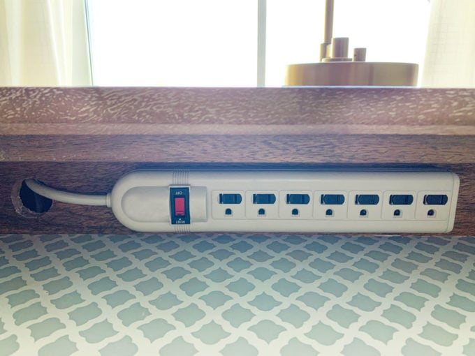 Power strip attached to nightstand in drawer for diy charging station