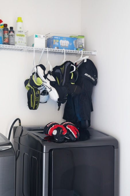 Hockey Equipment Hanging in Laundry Room